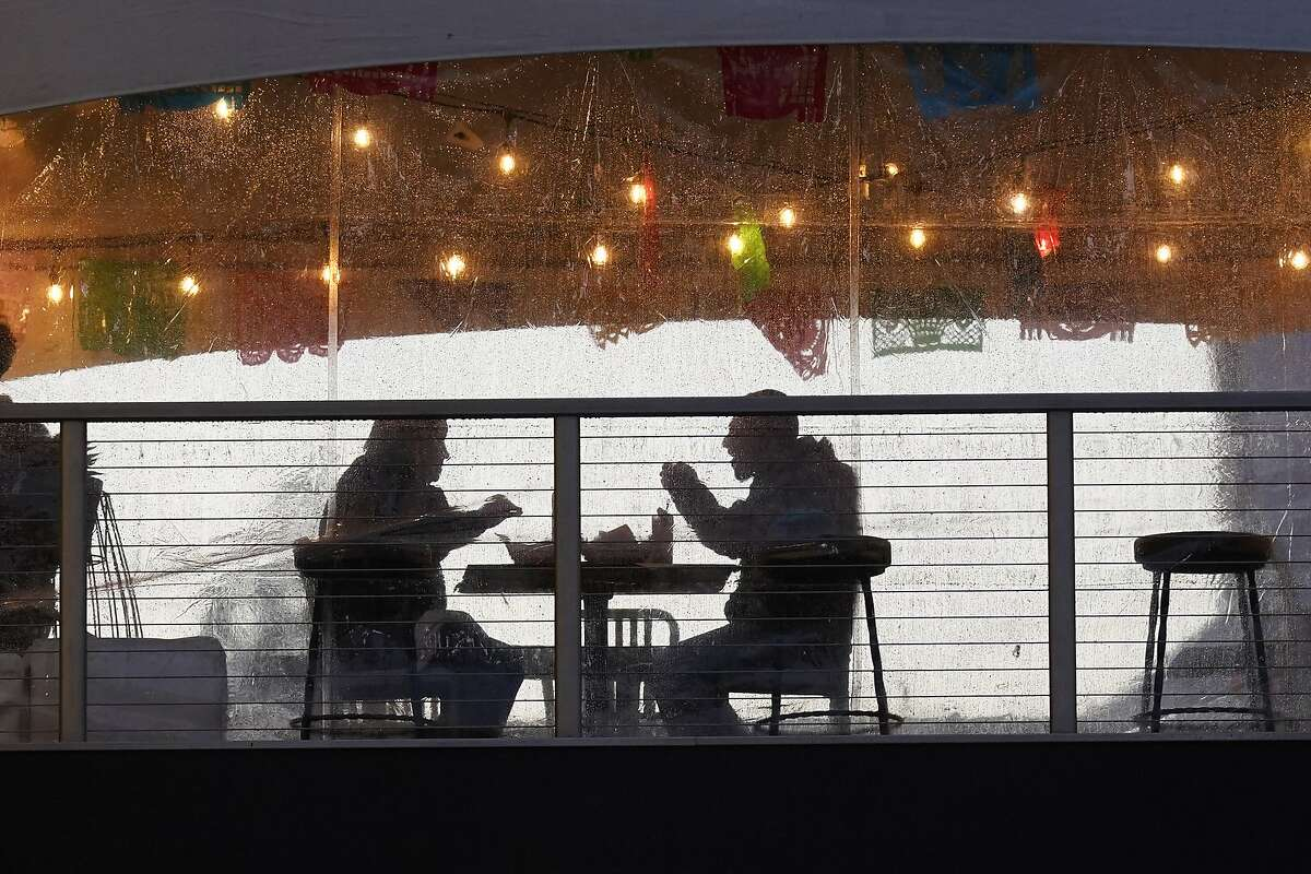 Diners enjoy a meal at the outdoor dining area at the Polanco Cantina in Sacramento. More places will be opening soon.