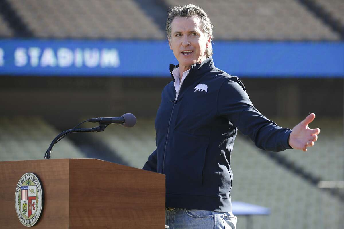 Gov. Gavin Newsom, pictured at a Jan. 15 vaccination event at Dodger Stadium, has lifted stay-at-home orders statewide in response to improving conditions.