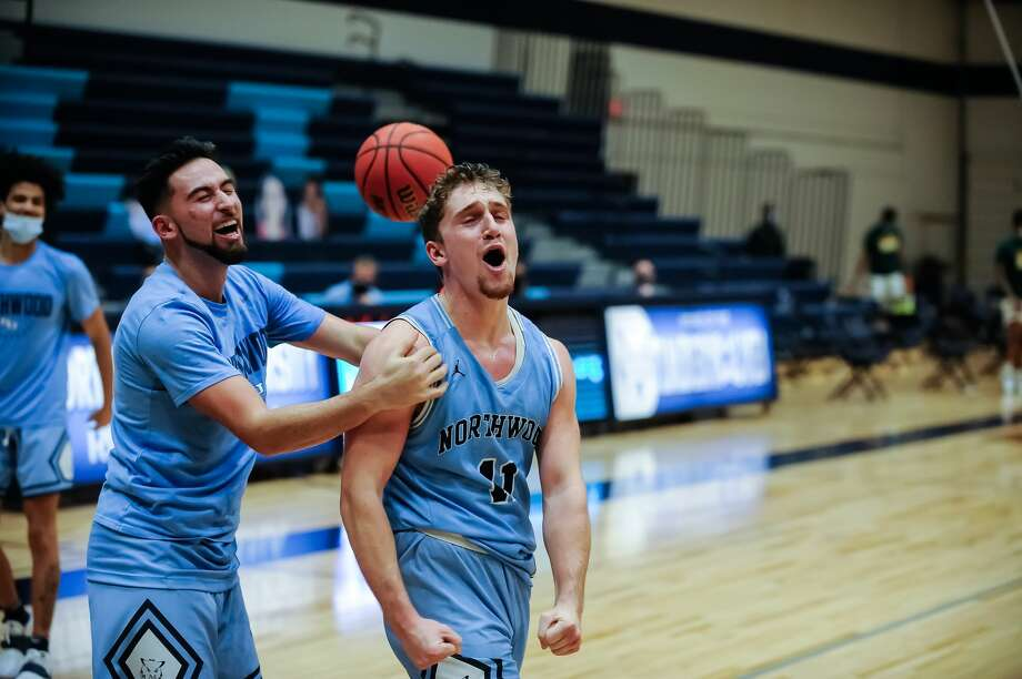 Northwood's Jack Ammerman celebrates his buzzer-beating 3-pointer following a Jan. 23, 2021 game against Wayne State. Photo: Daily News File Photo