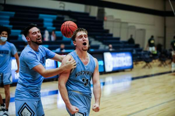 Northwood's Jack Ammerman celebrates his buzzer-beating 3-pointer following a Jan. 23, 2021 game against Wayne State.