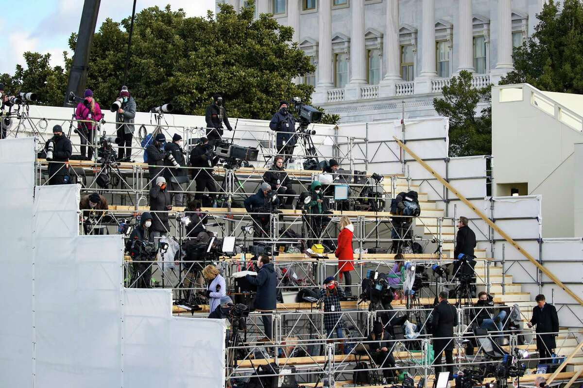 Members of the media await the inauguration of President Joe Biden. A reader says retired Judge Robert R. Barton is vague when blaming the media for an assault on U.S. democracy.