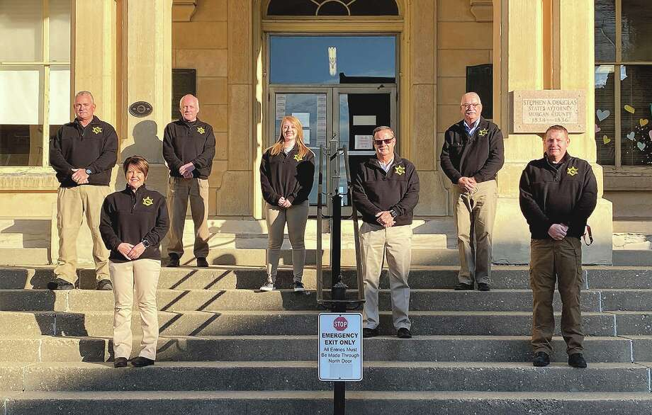 Coroner Marcy Patterson (front left) and her staff gather for a photo on the steps of the Morgan County Courthouse. Photo: Provided
