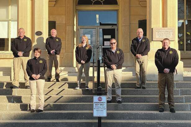Coroner Marcy Patterson (front left) and her staff gather for a photo on the steps of the Morgan County Courthouse.