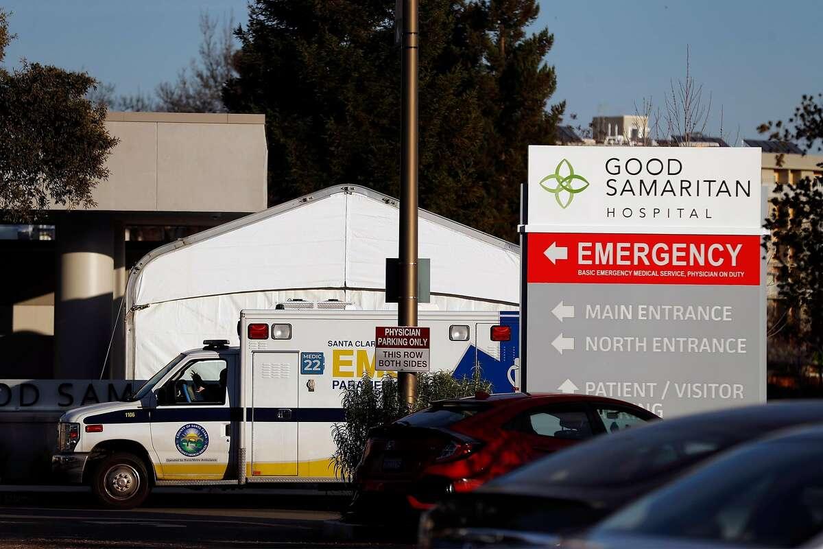 An ambulance waits outside the emergency room entrance at Good Samaritan Hospital in San Jose, Calif., on Thursday, January 7, 2021.