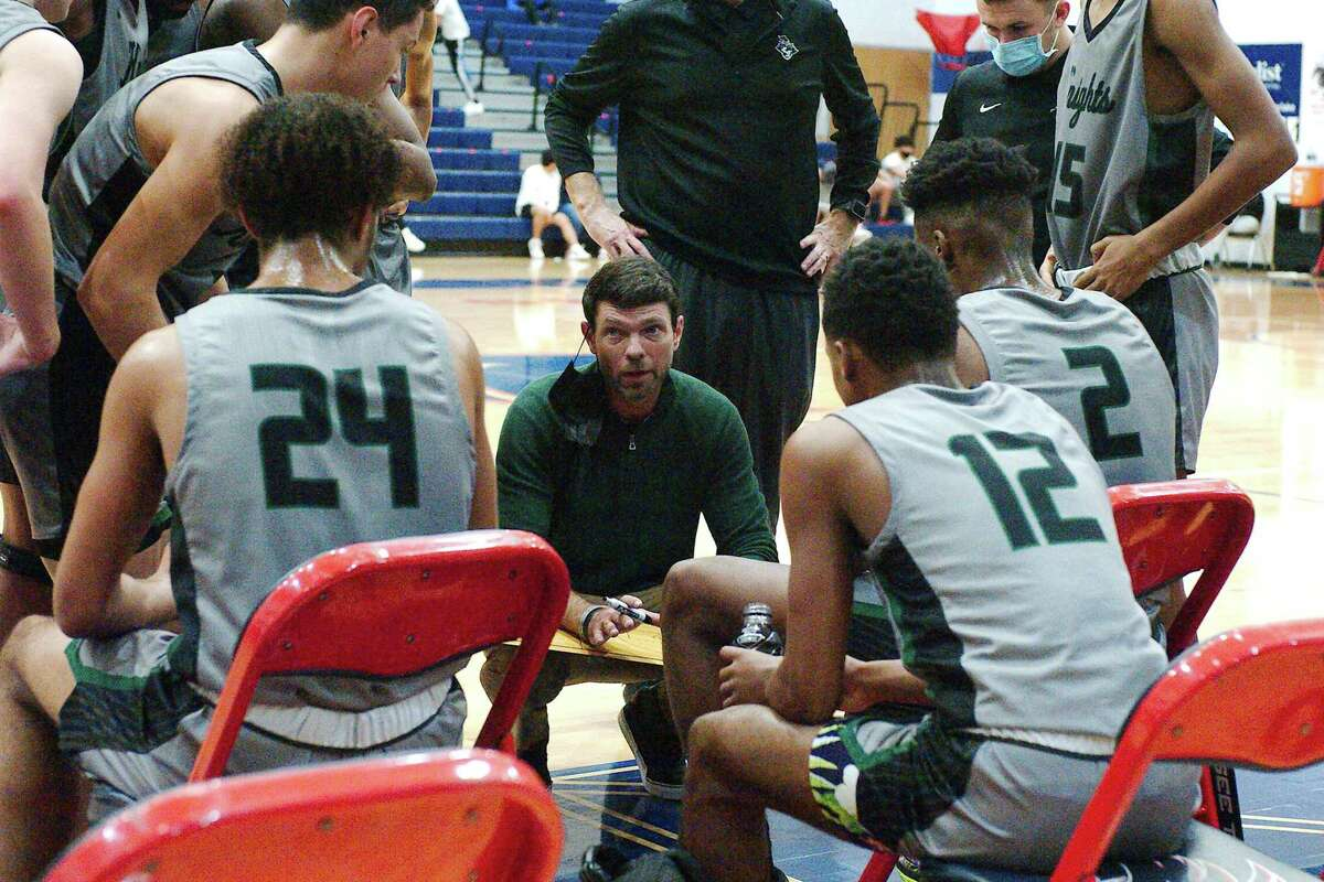 Clear Falls basketball coach Blake Joy speaks to his team during a break against last Friday at Krueger Fieldhouse.