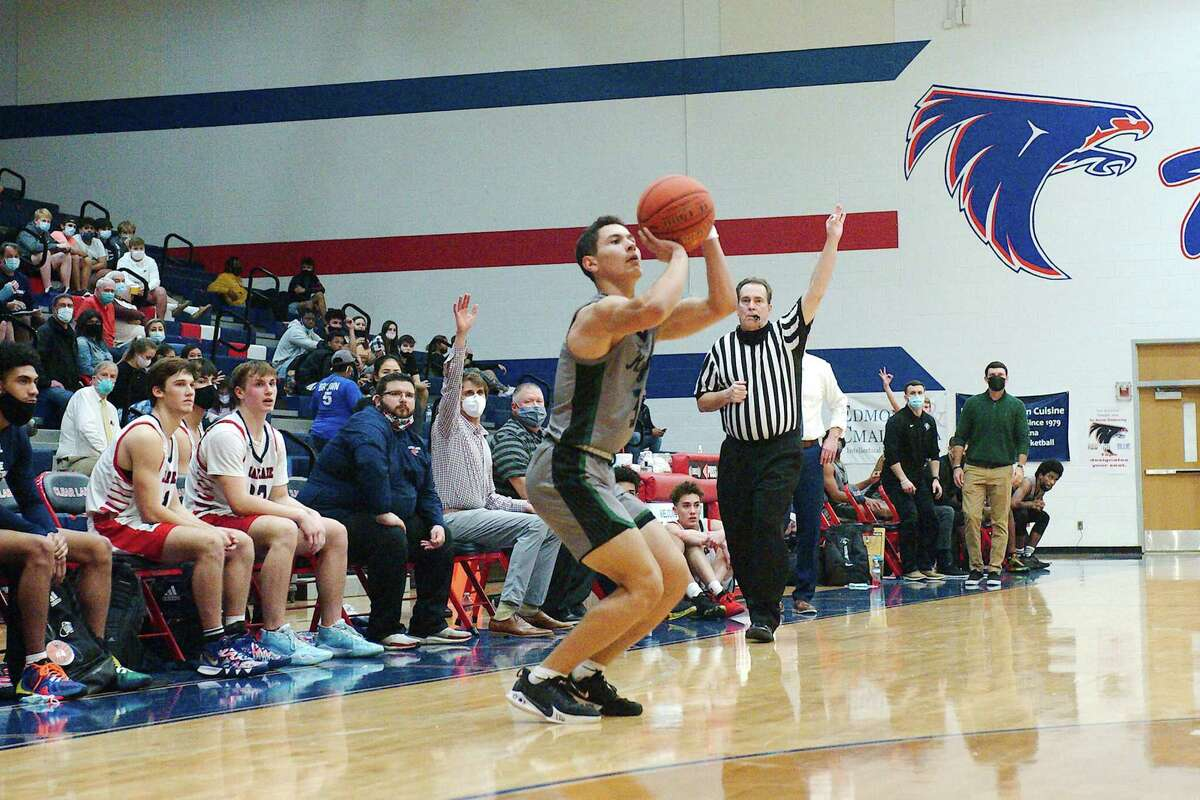 Clear Falls' Luke Vidal (3) prepares to launch a 3-pointer against Clear Lake last Friday at Clear Lake High School.