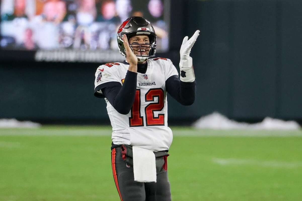 Tom Brady of the Tampa Bay Buccaneers celebrates in the fourth quarter against the Green Bay Packers during the NFC Championship game.