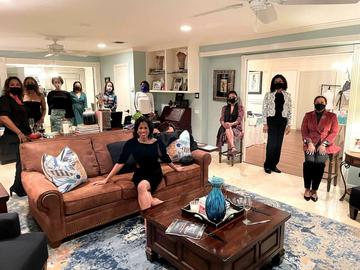 Honoree Roslyn Bazzelle Mitchell, center, hosted a Winter Ball watch party at her home.