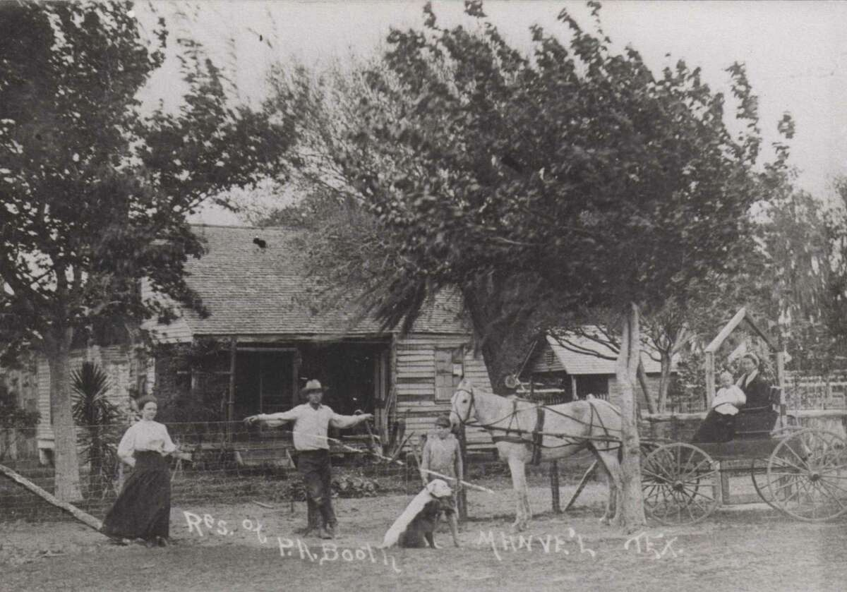 L.A. and Ida Booth in front of the first house built in the Manvel in this 1905 photo The house was built in 1857 and was at the head of Chocolate Bayou.