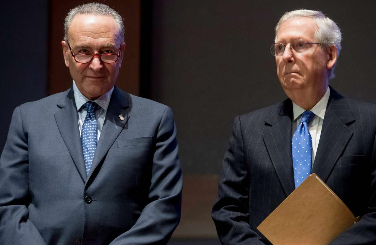 (FILES) In this file photo taken on November 9, 2017 US Senate Majority Leader Mitch McConnell (R) and US Senate Minority Leader Chuck Schumer (L) attend a ceremony honoring first responders with the US Capitol Police Medal of Honor for their actions during the shooting against members of the Republican Congressional baseball team in June, on Capitol Hill in Washington, DC. Schumer and McConnell are locked in a stalemate over the filibuster.(Photo by SAUL LOEB / AFP) (Photo by SAUL LOEB/AFP via Getty Images)