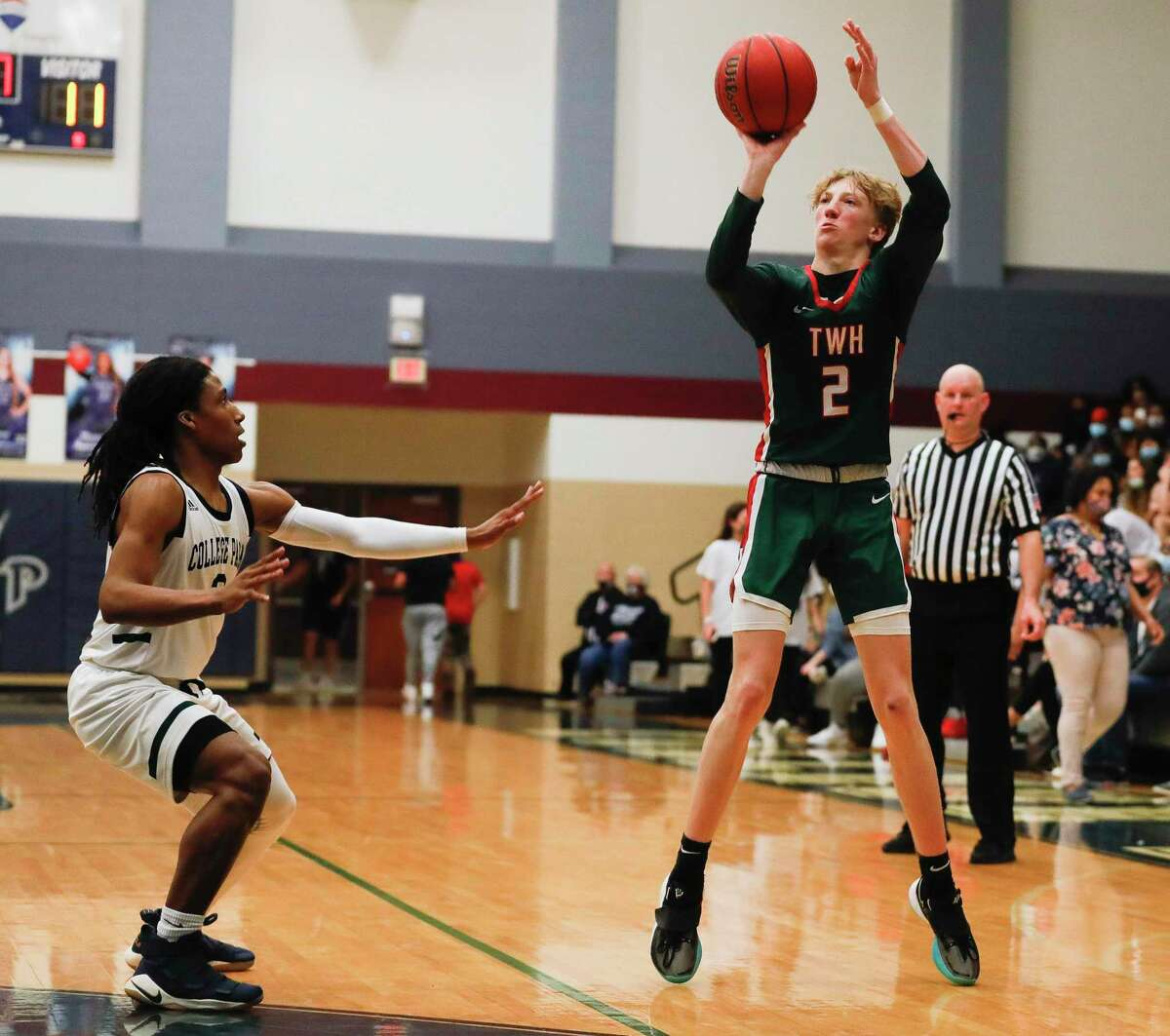 The Woodlands guard Shey Eberwein (2) shoots a 3-pointer during the first quarter of a District 15-6A high school basketball game at College Park High School, Saturday, Jan. 23, 2021, in The Woodlands.