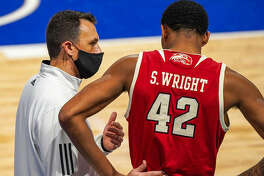 SIUE coach Brian Barone talks with the Cougars' Shamar Wright during a game earlier this season. After nine postponements, SIUE faces a busy stretch to make up games in the OVC.