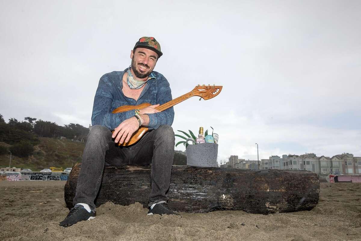 Joshua James plays a ukulele at Ocean Beach in San Francisco, California on Jan. 25, 2021. He just opened up Ocean Beach Cafe a block away from Ocean Beach.