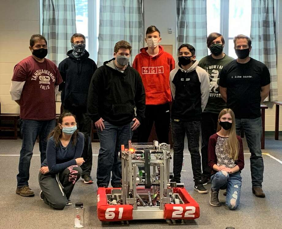 The Bear Lake robotics team, (front row, from left to right) includes Kara Smith and Kendelyne Schmidt; (middle row) Mentor Steve Gomez, Bryce Tracy, Gabe Aguilar and Coach John Prokes; (back row) Hunter Ball, Elias Klockow and Edward Fairchild. Not pictured is Megan Gydesen. Photo: Courtesy Photo