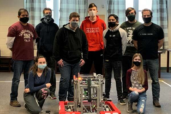 The Bear Lake robotics team, (front row, from left to right) includes Kara Smith and Kendelyne Schmidt; (middle row) Mentor Steve Gomez, Bryce Tracy, Gabe Aguilar and Coach John Prokes; (back row) Hunter Ball, Elias Klockow and Edward Fairchild. Not pictured is Megan Gydesen.