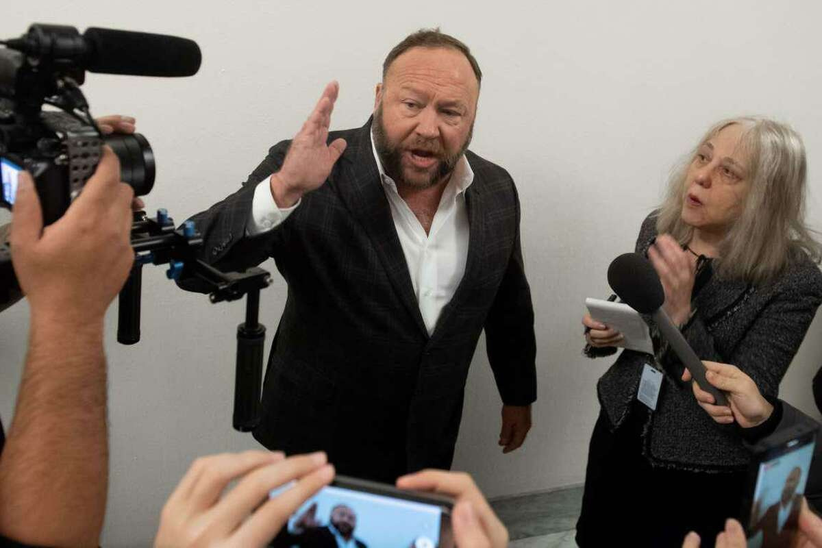 File photo - Extremist Alex Jones speaks outside the hearing room prior to testimony by Google CEO Sundar Pichai during a House Judiciary Committee hearing on Capitol Hill in Washington, DC, Dec. 11, 2018.