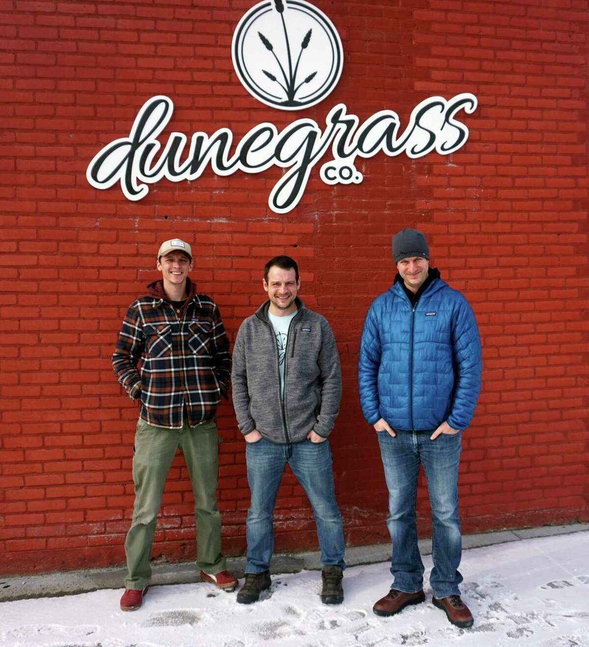 From left to right: cousin Chris Piedmonte stands with brothers Eric and Nick Piedmonte in front of the soon-to-open Dunegrass Co. adult-use cannabis facility. (Pioneer photo/Joe Judd)