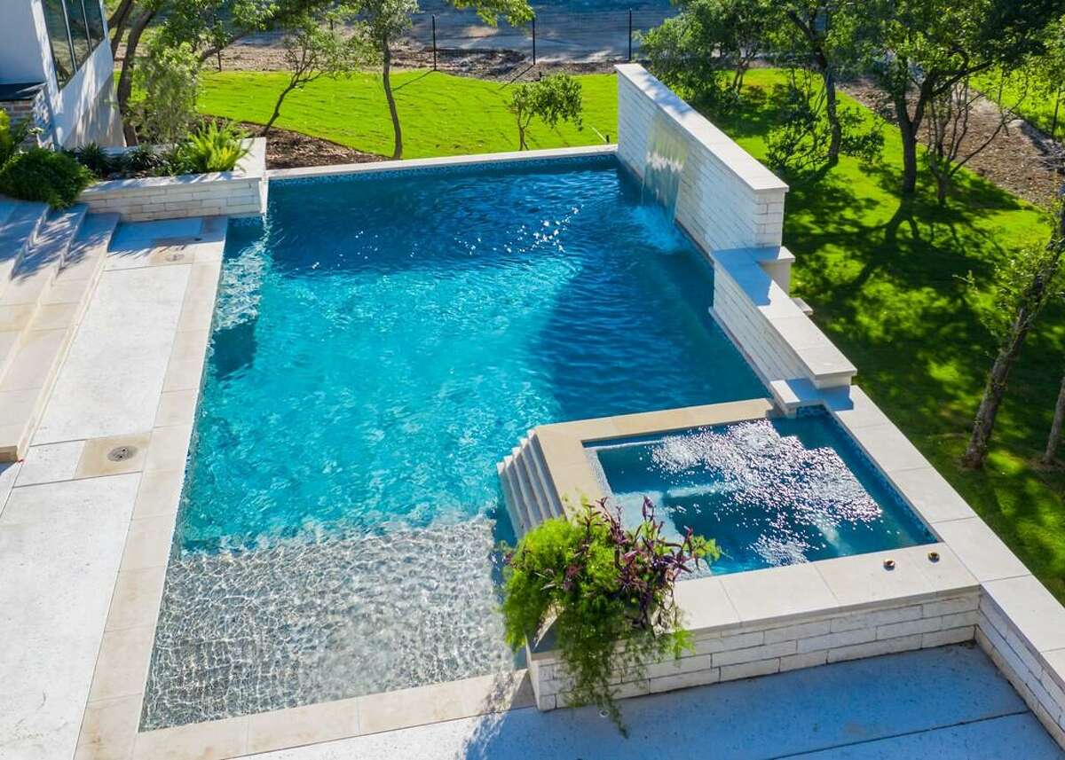 Pool builders say that many Texans are investing in backyard swimming pools as the staycation of 2020-2021.