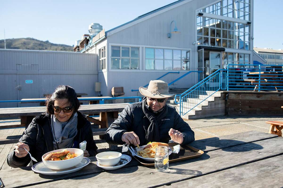 Ajith (right) and Anoma Amerasekera of Berkeley dine at Fish restaurant in Sausalito, which opened for outdoor service as soon as Gov. Gavin Newsom gave the go-ahead on Monday. Marin County announced that restaurants could open immediately.