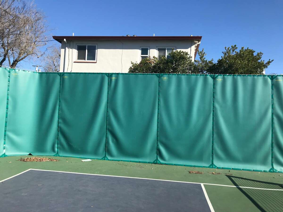 The new green sound barriers at the Cedar Rose pickleball courts in Berkeley, California. After neighbor complaints about the constant din of the pickleball games, the city of Berkeley put in these barriers to hopefully lessen the problem.