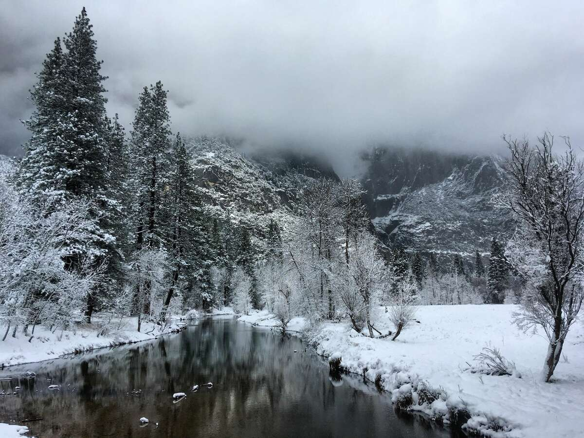 The Merced River banks, blanketed in snow.