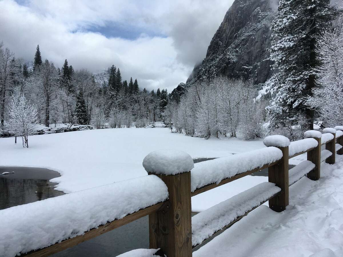 A snow-covered swinging bridge in Yosemite National Park.