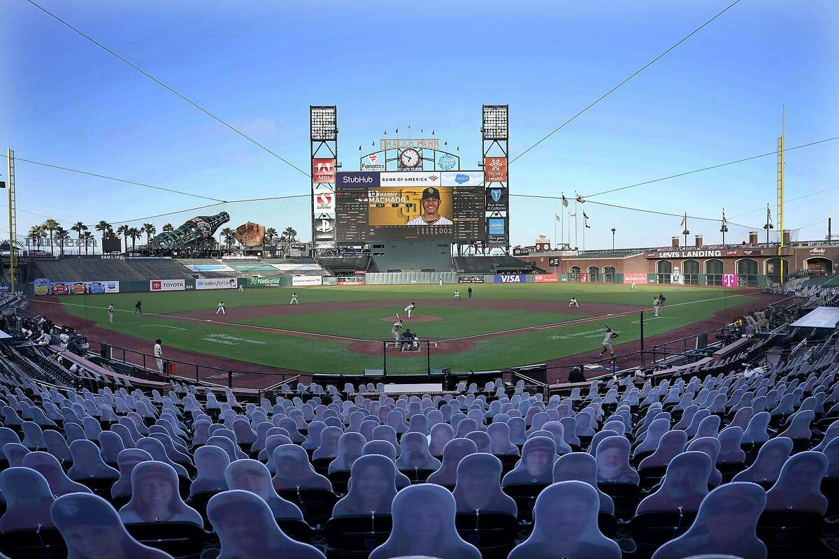 Cardboard cutouts rest in seats at Oracle Park as the San Francisco Giants play the San Diego Padres during the first inning of a baseball game in San Francisco, in this Wednesday, July 29, 2020, file photo.