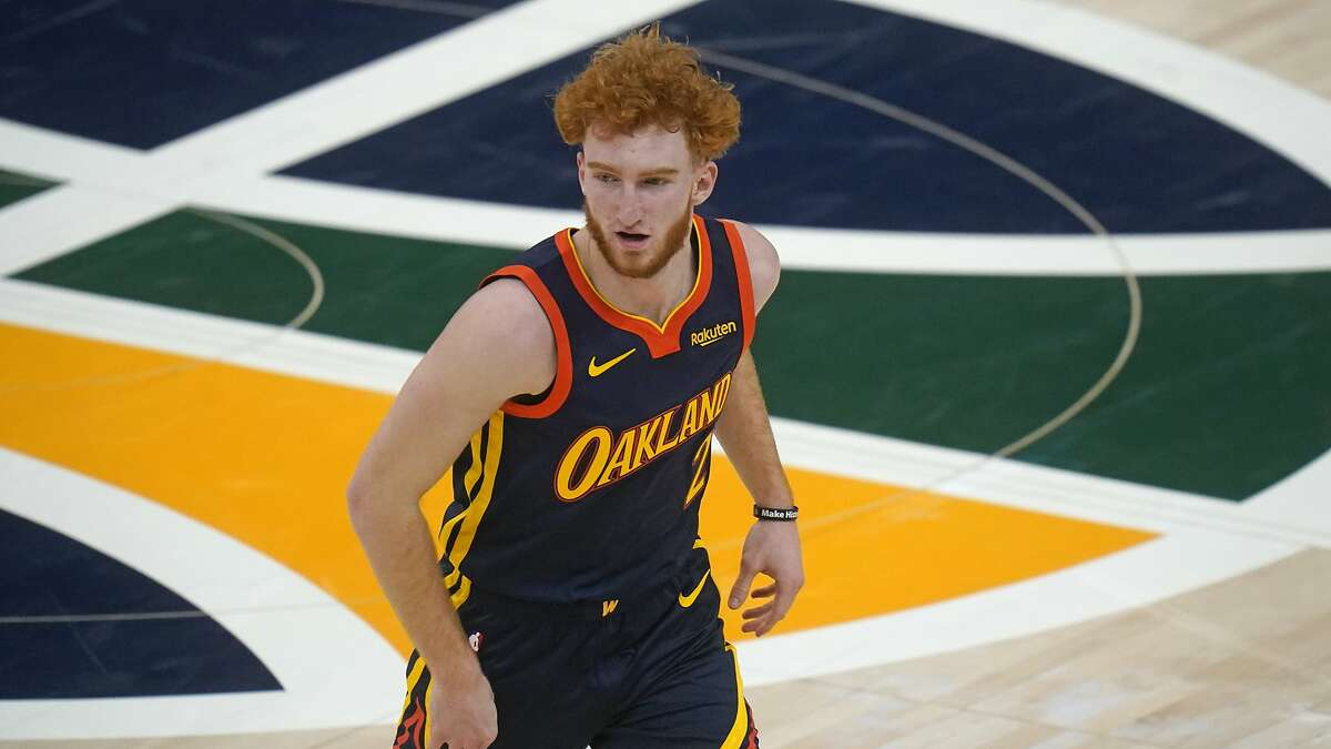 Golden State Warriors guard Nico Mannion (2) runs up court in the second half during an NBA basketball game against the Utah Jazz Saturday, Jan. 23, 2021, in Salt Lake City. (AP Photo/Rick Bowmer)