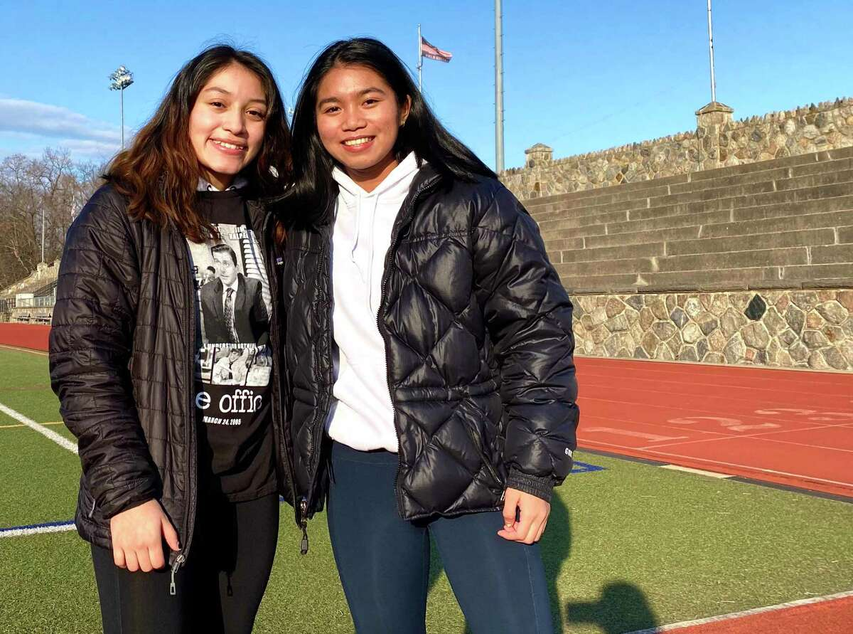 Stamford wrestlers senior Vienna Prado and sophomore Samantha Yap at Boyle Stadium Thursday. A year after the first girls state wrestling tournament, the sport is on hold. Yap was the 106 pound girls state champion last year.