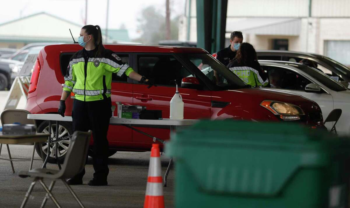 Montgomery County Hospital District paramedics direct residents in vehicles at Montgomery County's first mass COVID-19 vaccination site at the Montgomery County Fairgrounds on Wednesday in Conroe. Montgomery County residents will have several opportunities to receive a COVID-19 vaccination this week in Conroe and The Woodlands.