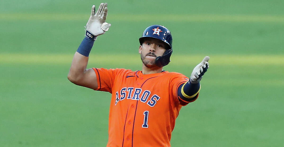 Houston Astros Carlos Correa reacts after hitting a double against the Tampa Bay Rays of Game 6 of the American League Championship Series at Petco Park Friday, Oct. 16, 2020, in San Diego.