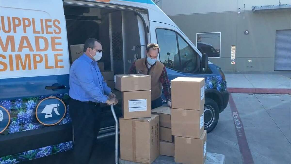 Paul Richmond (left) of Richmond Advantage in Schertz helps San Antonio Food Bank President Eric Cooper unload boxes of personal protective equipment for use by food bank workers and volunteers and for distribution to those in need of the products.