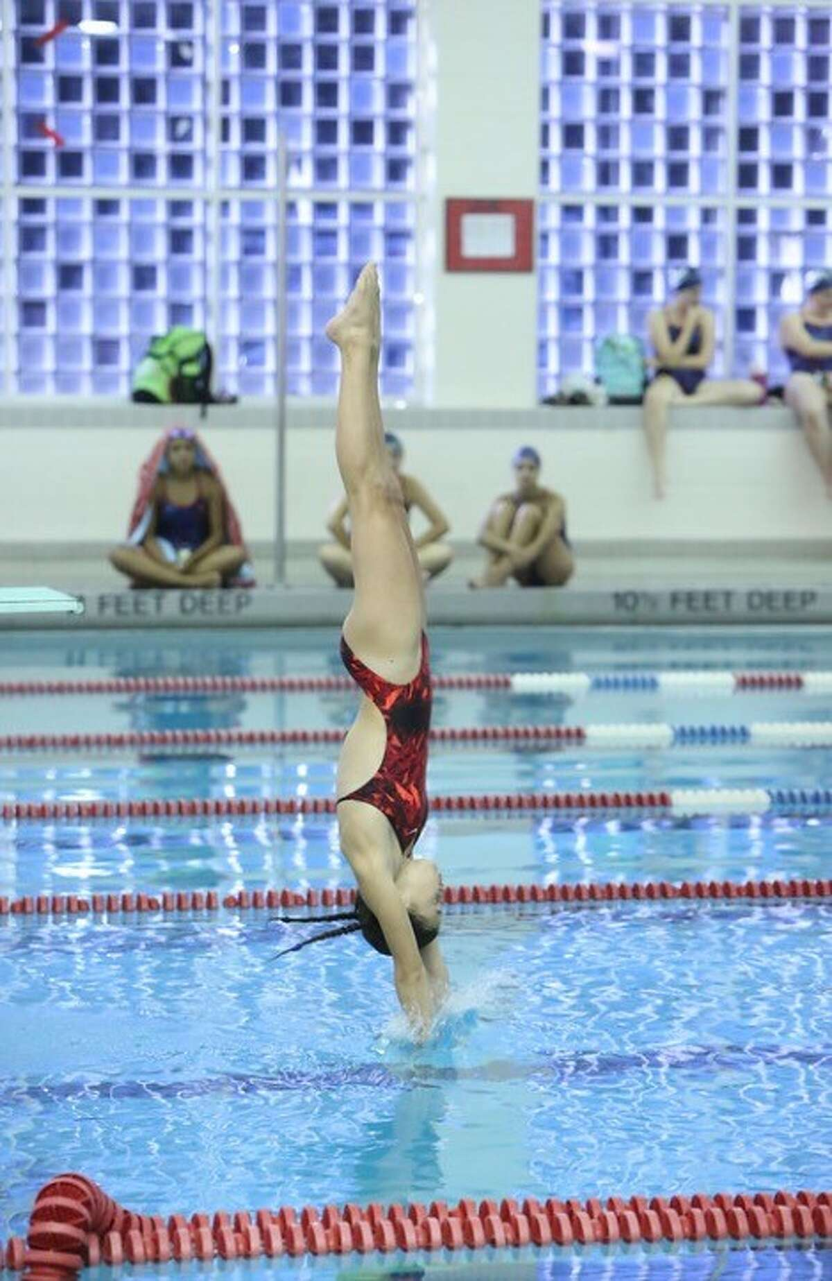 Maddy Altieri of Guilderville completes a dive.