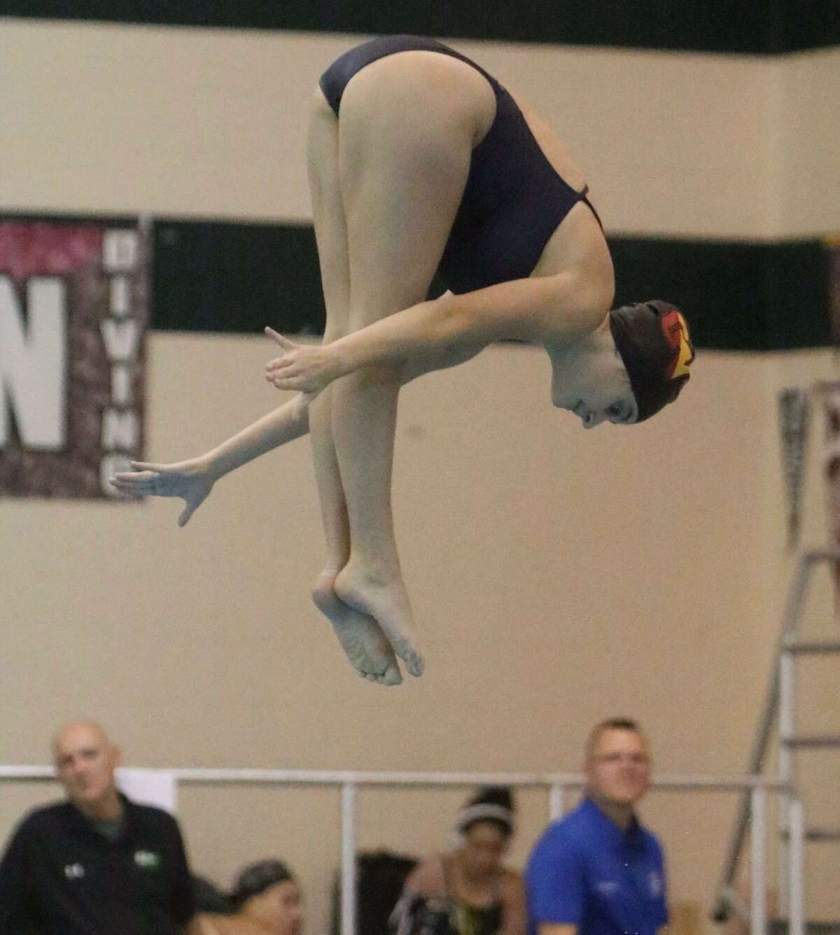 Maddy Altieri of Guilderville competes in diving. She signed a letter of intent to go to Division I Rider.
