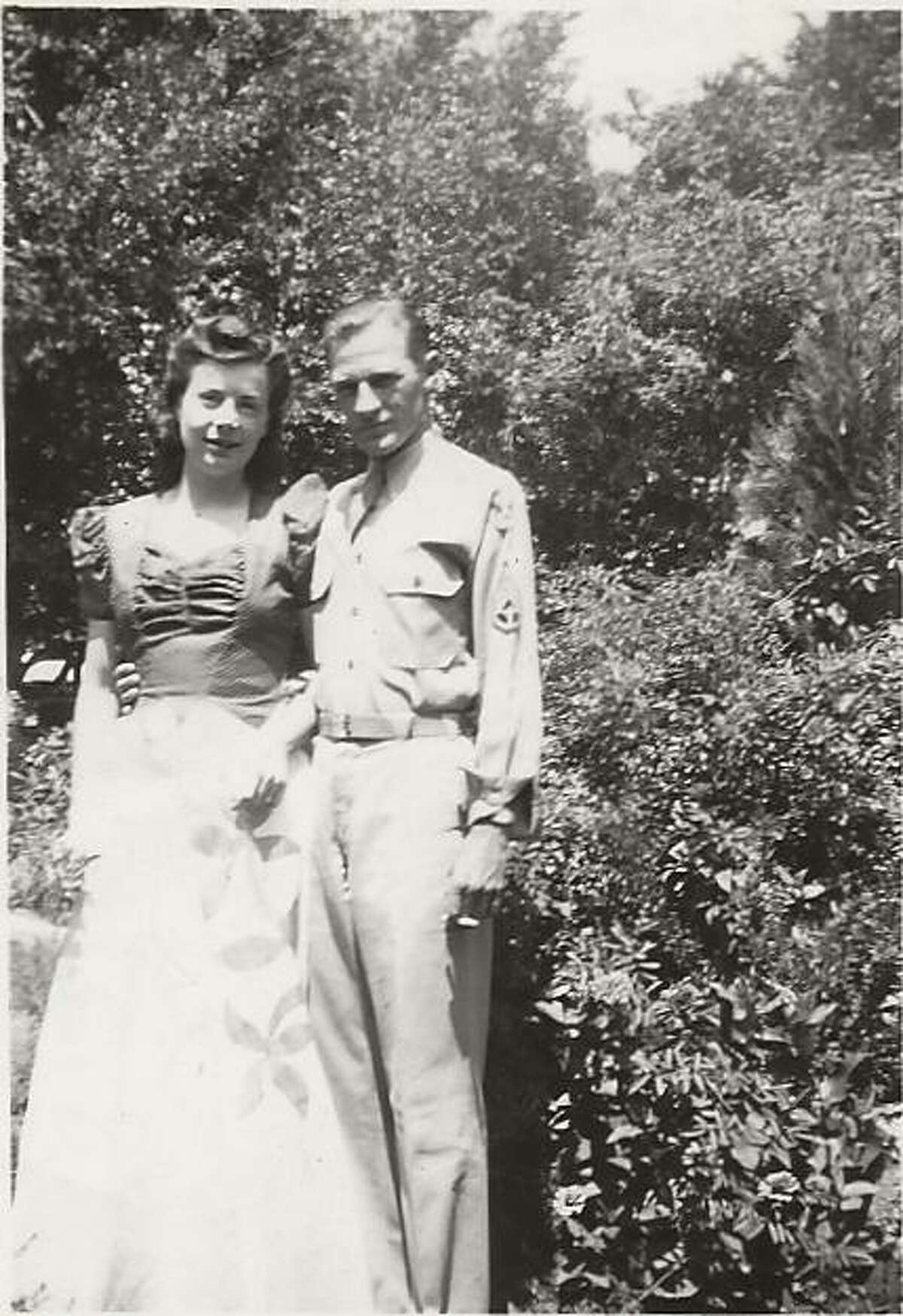 The photo is courtesy of Beverly Dagley Yeager, Evelyn's daughter. It might be a wedding day photo of Evelyn and Eugene Reed on August 10, 1942. She is wearing a formal dress and he is wearing his glider pilot uniform.