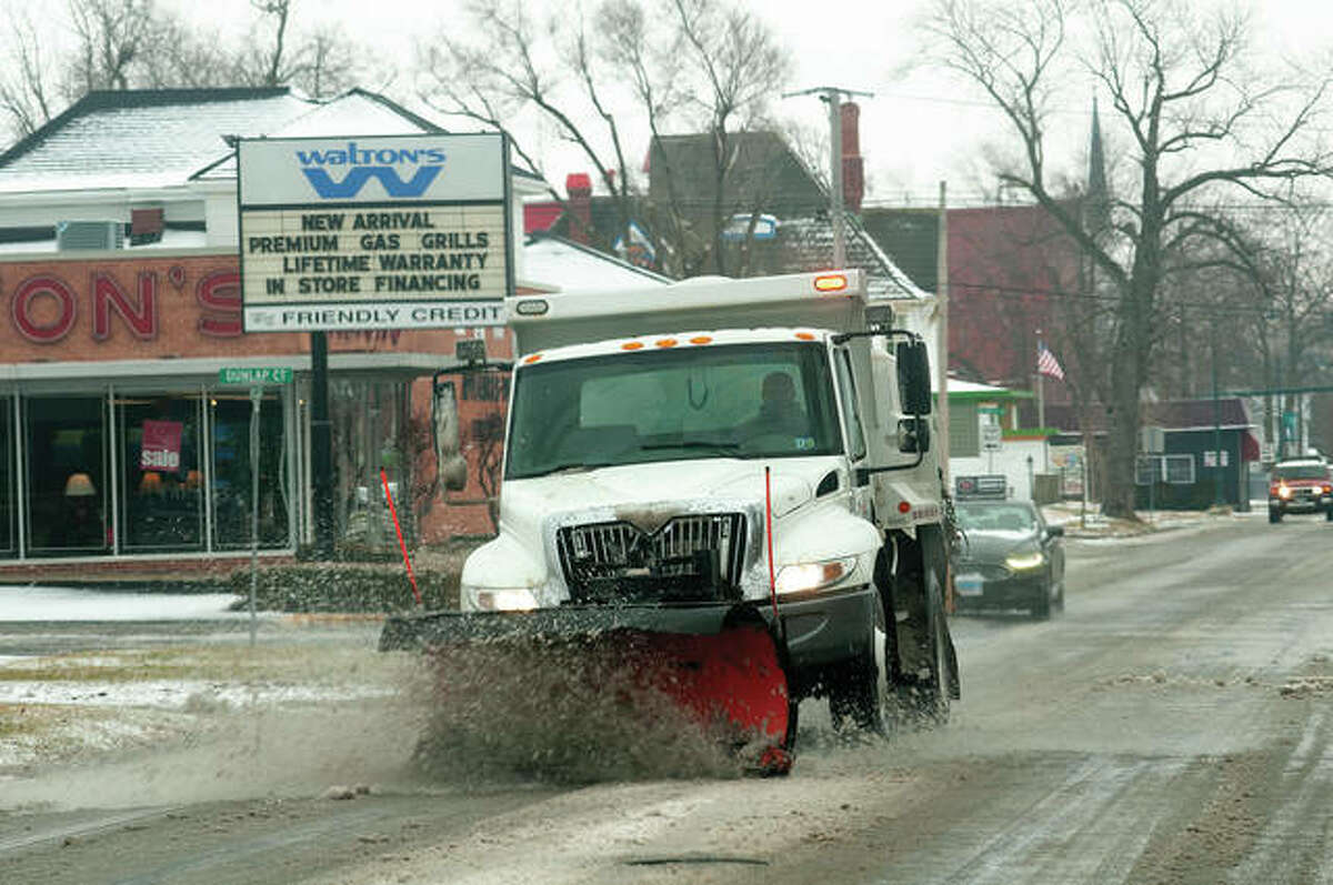 Jacksonville city workers plow along College Avenue after snow and ice fell Monday in the region. More of a wintry mix was possible overnight, with a chance of snow today and Wednesday morning before skies are expected to clear up Thursday, according to the National Weather Service.