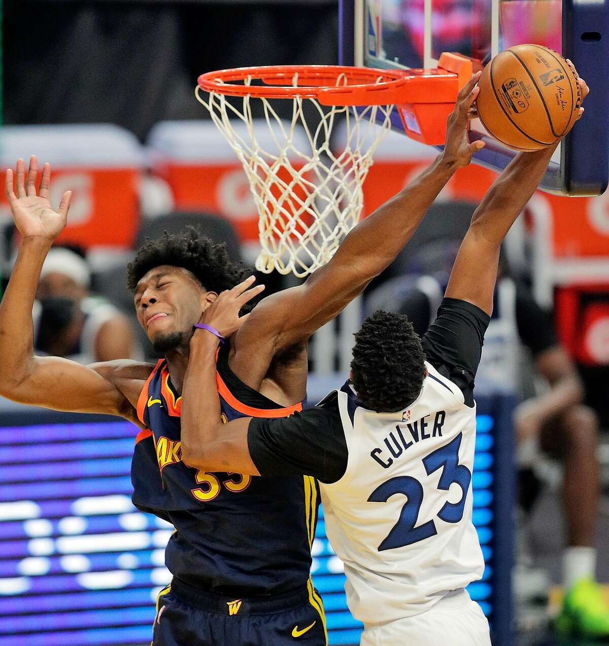 Warriors rookie center James Wiseman tries to block a shot by Minnesota's Jarrett Culver in the first half at Chase Center.