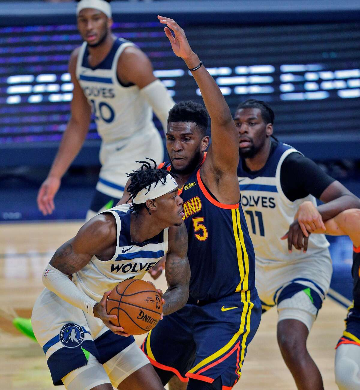 Kevon Looney (5) defends against Jarred Vanderbilt (8) in the first half as the Golden State Warriors played the Minnesota Timberwolves at Chase Center in San Francisco, Calif., on Monday, January 25, 2021.
