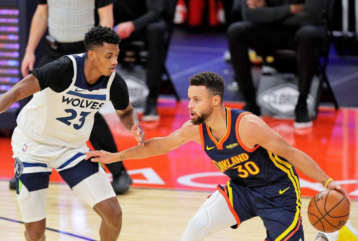 Stephen Curry (30) drives to the basket defended by Jarrett Culver (23) in the first half as the Golden State Warriors played the Minnesota Timberwolves at Chase Center in San Francisco, Calif., on Monday, January 25, 2021.