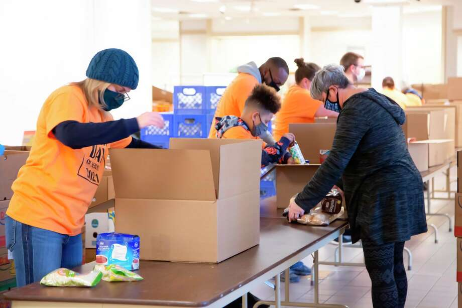 Volunteers are packaging food for the first food distribution. (Photo Provided)