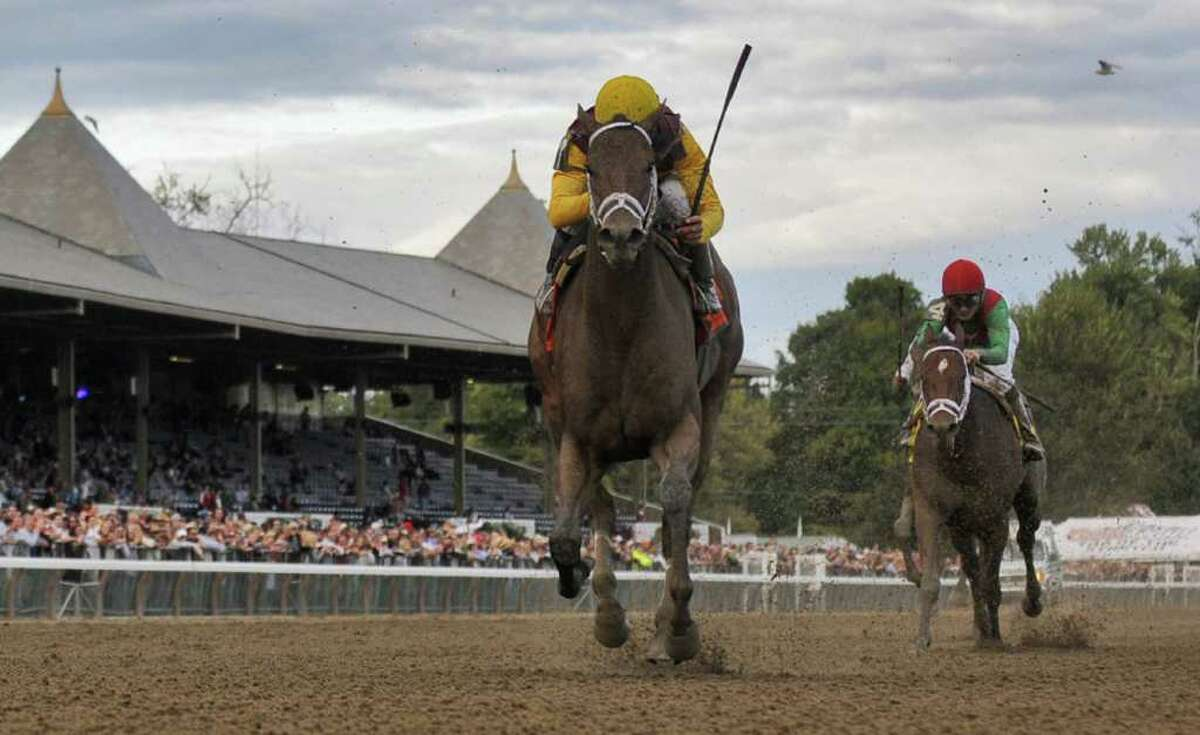 Jockey Garrett Gomez, left, urges R Heat Lightning to the finish line and victory in the 119th running of The Spinaway Grade I race on Sunday at Saratoga Race Course on Sept. 5, 2010.