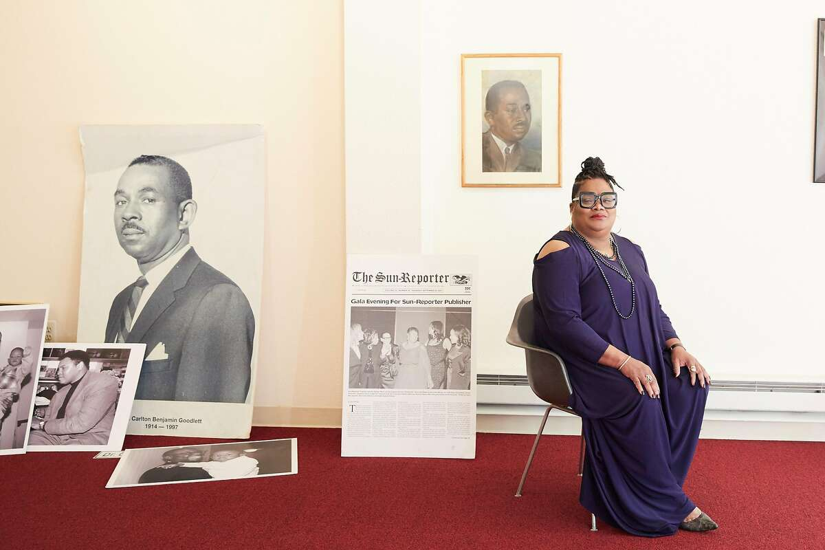 Amelia Ashley-Ward, publisher of San Francisco's oldest Black newspaper, the Sun-Reporter, sits for a portrait surrounded by images of the publication's iconic founder, civil rights leader Dr. Carlton Goodlett in 2020.