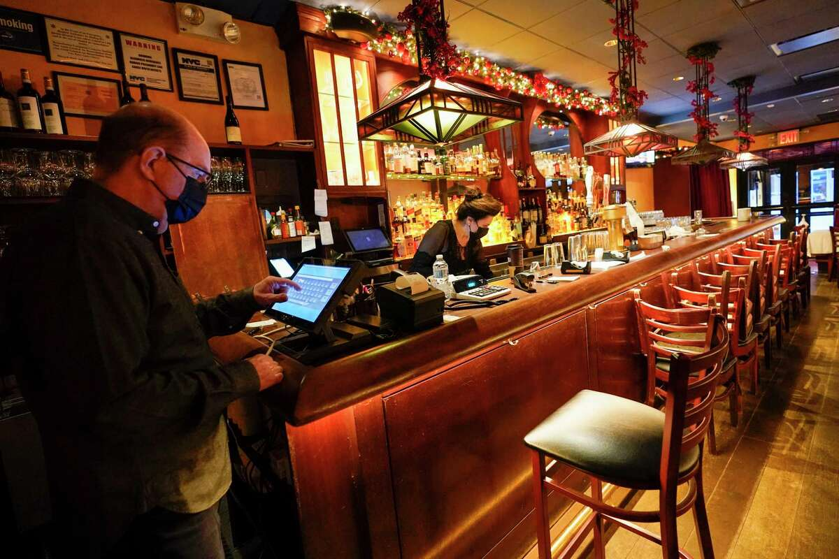 Under current state regulations, after 10 p.m. only employees are allowed in restaurants that serve alcohol. The New York State Restaurant Association is urging the Cuomo administration to extend closing time until midnight to allow for extra income for an industry that's been hit hard by the nearly 11-month-old curtailment of business as a result of the coronavirus pandemic. (AP Photo/Mary Altaffer)