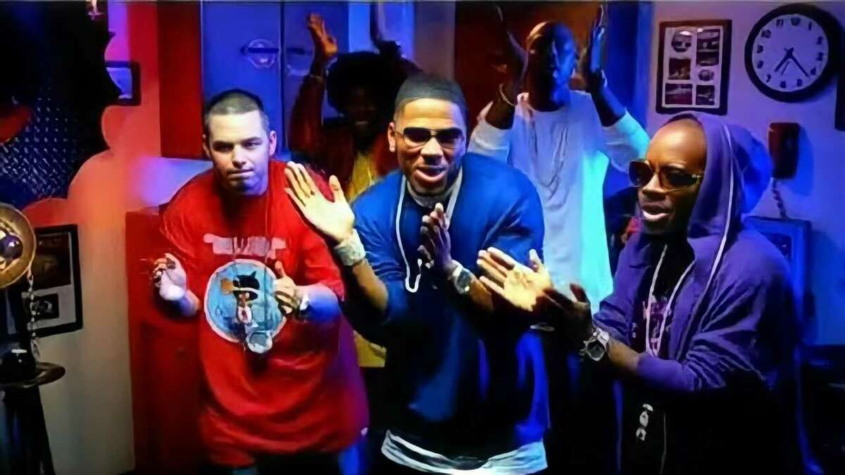 Screenshot from 'Grillz' music video. From left to right (Paul Wall, Nelly, and Jermaine Dupri)