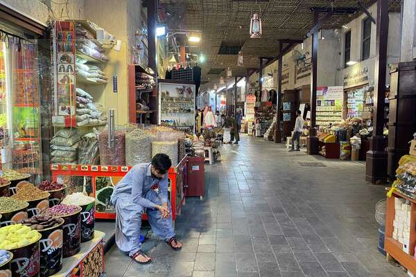 A shopkeeper rests on Saturday in Dubai's empty Old Souk market, where business has decreased amid rising coronavirus cases in the city.