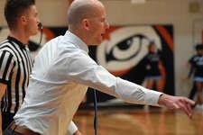 Edwardsville boys basketball coach Dustin Battas instructs his team during a game last season inside Lucco-Jackson Gymnasium.