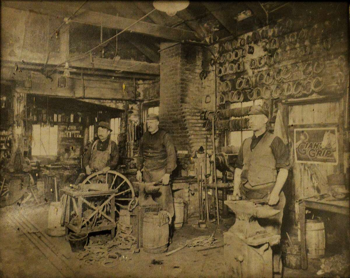 The interior of J. Becker and Sons' wagon and sleigh shop in the early 1900s at 49 Quail St. in Albany. Founder Jacob Becker is in the middle.