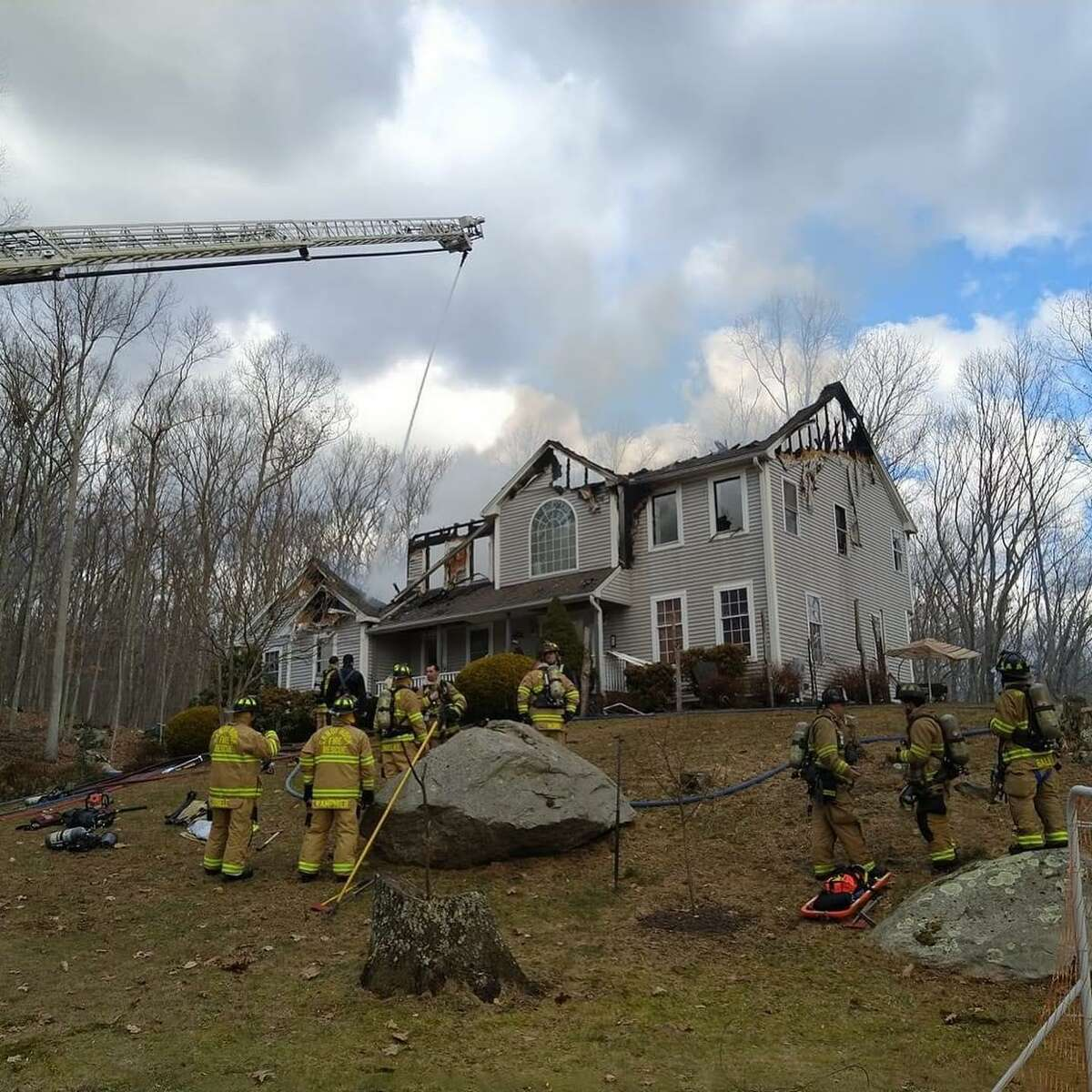 A Newtown family of 14 has been displaced following a Friday morning fire destroyed their Aspen Lane home.