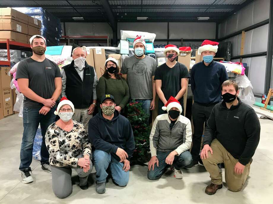 Ashley Furniture in Bad Axe continued their Kids in Need of a Bed program despite changes made due to the pandemic. Store employees volunteered their time to donate beds to Upper Thumb children in need for the seventh year in a row. (Courtesy Photo)