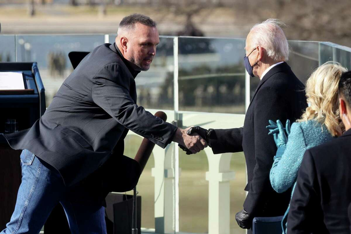 WASHINGTON, DC - JANUARY 20: U.S. President Joe Biden shakes hands with singer Garth Brooks after Brooks performed at his inauguration on the West Front of the U.S. Capitol on January 20, 2021 in Washington, DC. During today's inauguration ceremony Biden becomes the 46th President of the United States. (Photo by Jonathan Ernst-Pool/Getty Images)